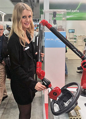 A hostess with the new Ace 7 axes measuring arm